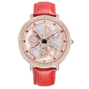 マザーオブパールのモチーフが回転 DAVENAダヴェナ腕時計フォルマ forma 赤/ピンクゴールド スワロフスキークリスタル使用