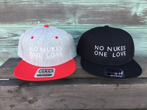 "strip × WHATEVER WORKS ""NO NUKES Cap"""
