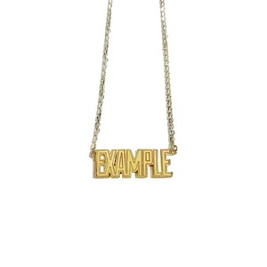 【限定受注販売】 EXAMPLE x GARNI EXAMPLE LOGO PENDANT GOLD TOP(SMALL)