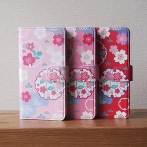 桜と雪輪の手帳型スマホケース