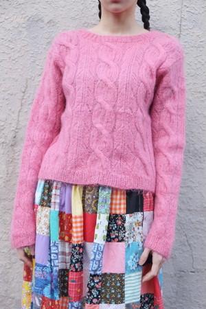 pink hallucination knit sweater.