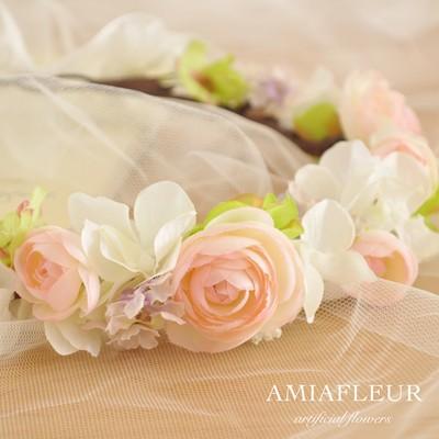 ふんわり優しい、クリームピンクのラナンキュラスを使った花冠