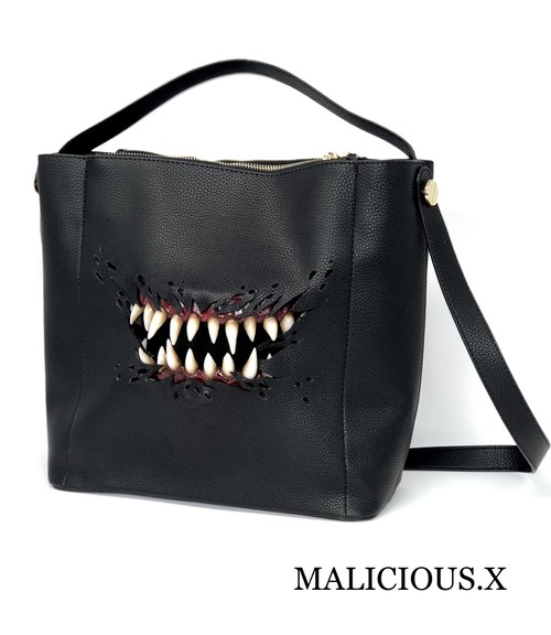 creature cross body & handbag