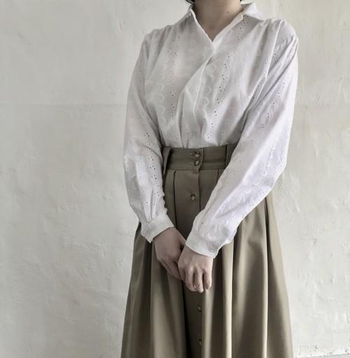 Cutwork lace white shirt.