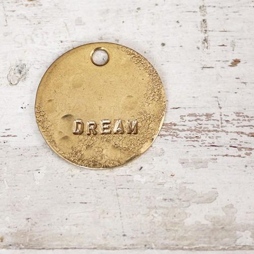 真鍮のペンダント・ラッキーチャーム(DREAM) (直径約25mm)