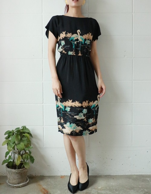 black flamingo motif dress