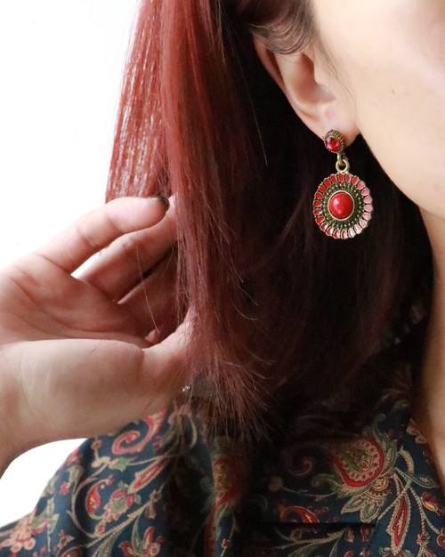 red stone pierced earrings