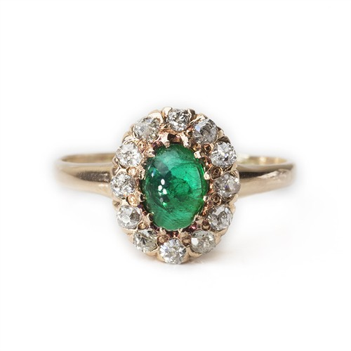 Emerald cabochon Diamond Halo Ring