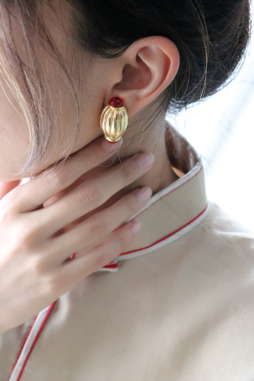 dead stock red × gold earrings