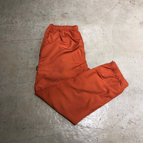 NOTHIN'SPECIAL NYLON WIND PANTS / RUST