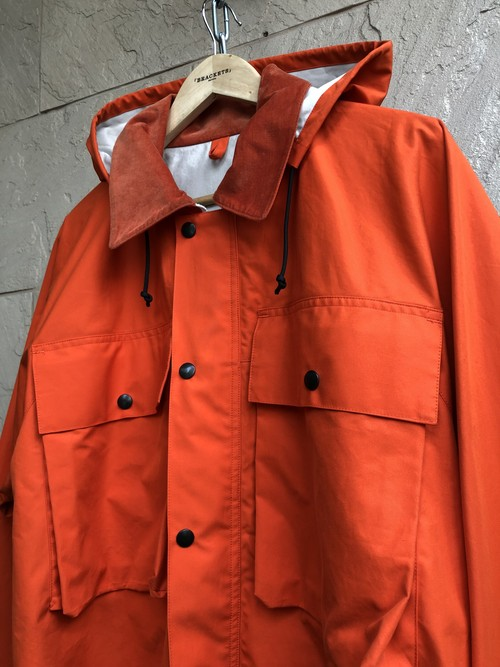 "「BRACKETS」  ""Ventile"" fabric fishing jacket orange color"