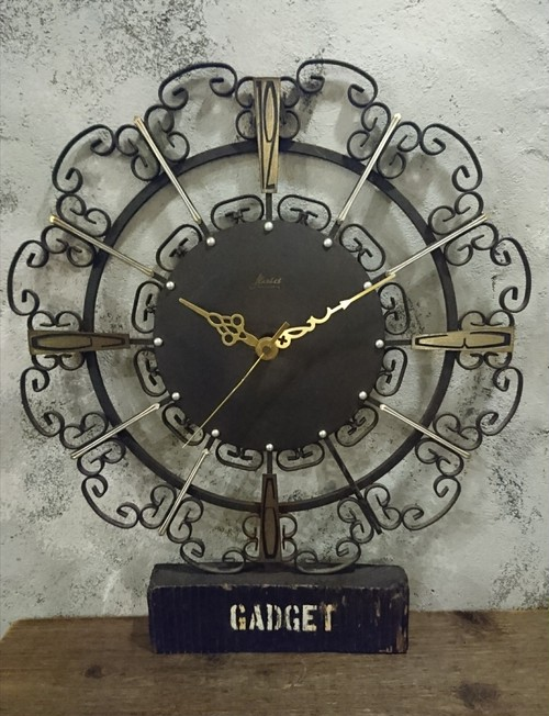 1960s  Kaid Iron Sunburst Wall Clock