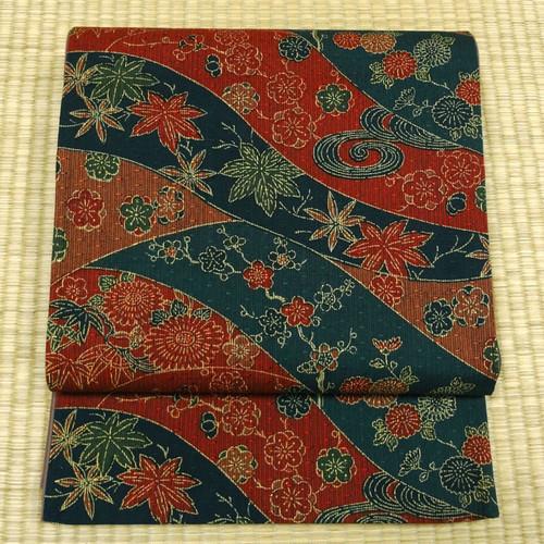 渋めの赤と青の織りに草花 洒落袋帯