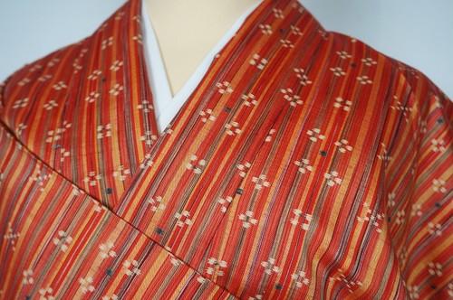 美品 手織り節紬 絣 縦縞 赤 オレンジ 131