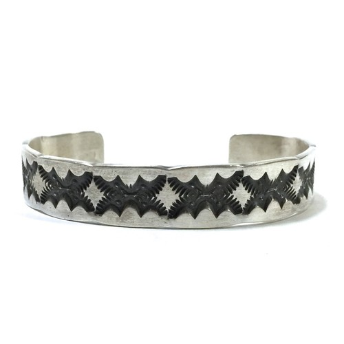 Navajo Vintage Sterling Silver Stamp Bangle by Nora Begay