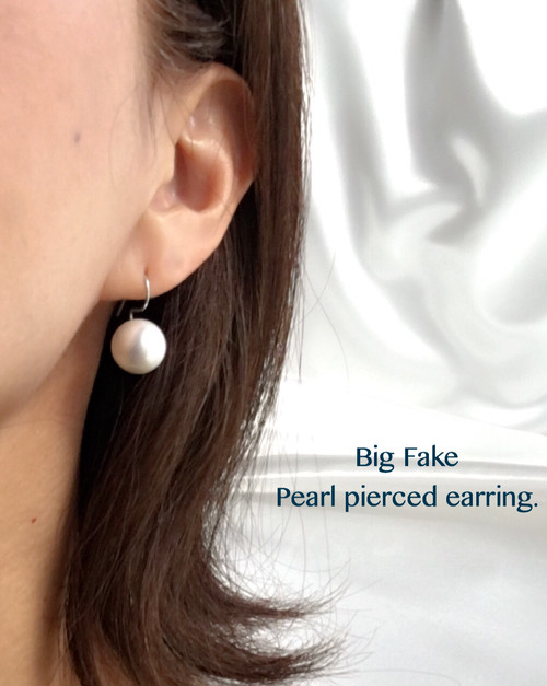 Big Fake Pearl pierced earring.
