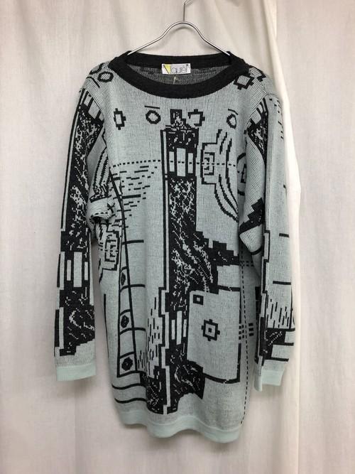 記号のような柄のセーター