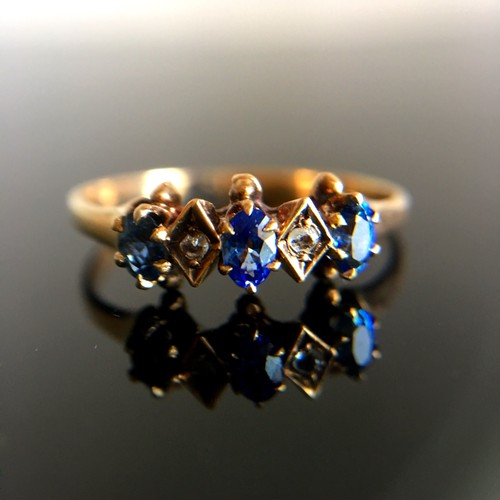 Turn of the Century  Sapphire&Diamond Three Stone Ring