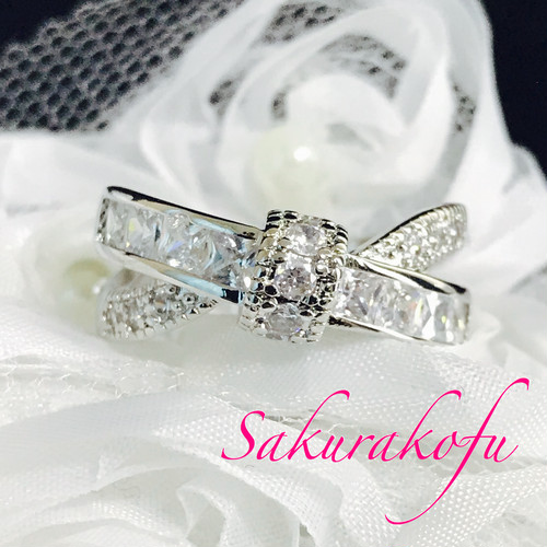 D035 Cross Ribbon  White Sapphire Ring