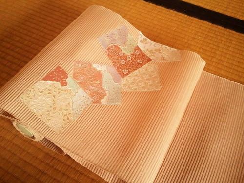 絽綴れ八寸帯 082 薄茶地色紙取七宝小花