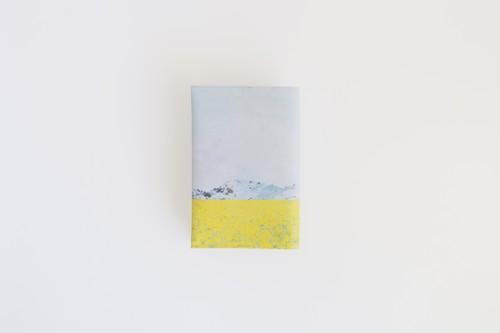 菜の花と青空を描いた、ブックカバー
