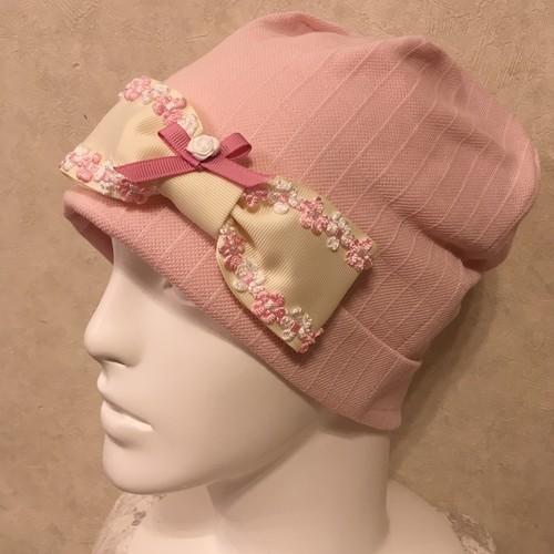 お花のモチーフ付きリボンのケア帽子 ピンク