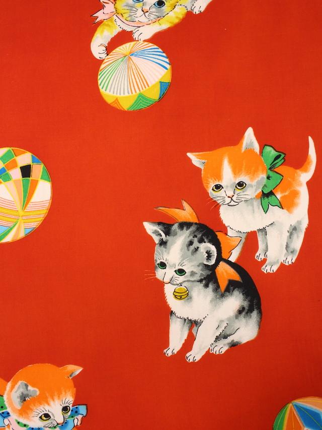 赤地リボン猫と手毬仕立て上り名古屋帯