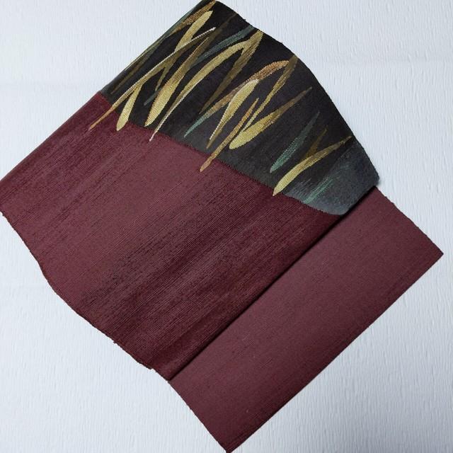 【お太鼓柄】8寸開き名古屋帯 松葉仕立て 紬地手織り ゴールド草織出し あずき色