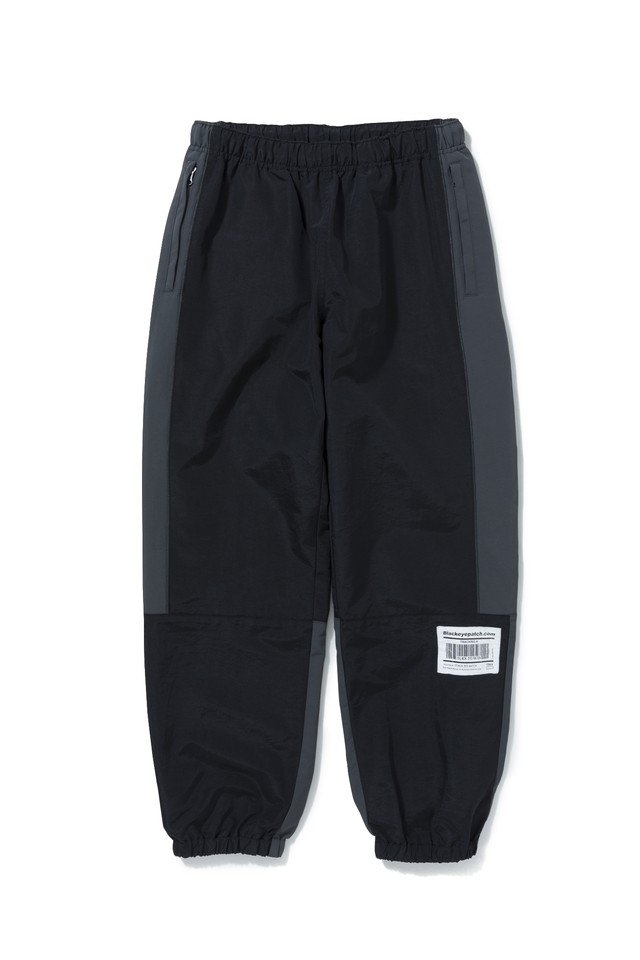 BLACK EYE PATCH / NYLON TRACKING PANTS