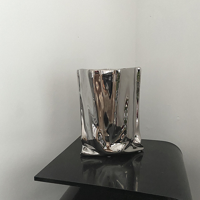 metallic figurative vase