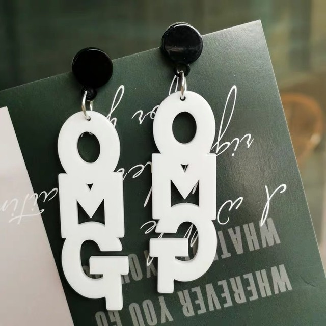 omg logo pierced earrings