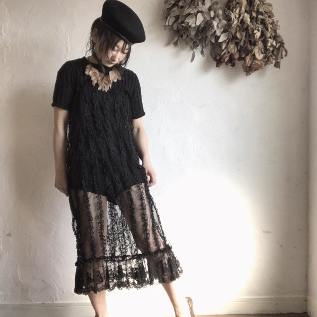 See through black lace skirt