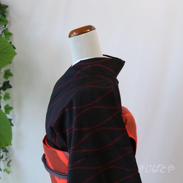 正絹紬 黒地に赤の立涌の小紋 袷