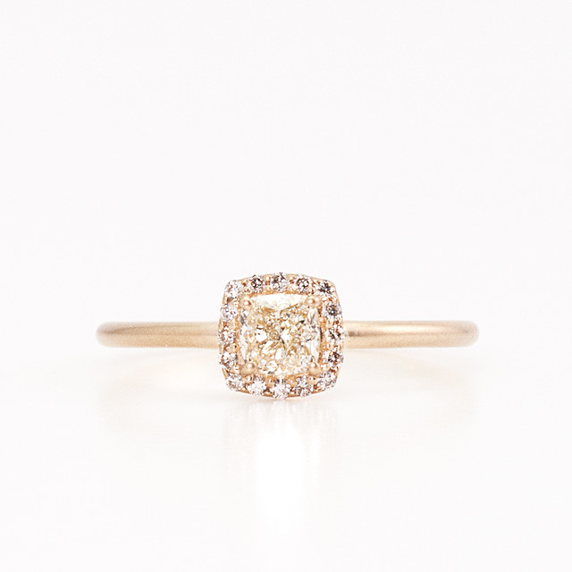Cushion cut diamond surround ring
