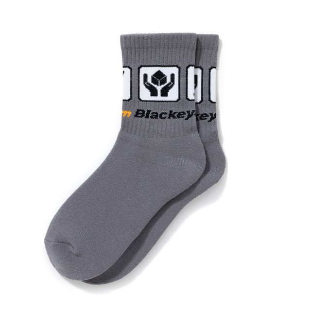 BLACK EYE PATCH / HANDLE WITH CARE SOCKS