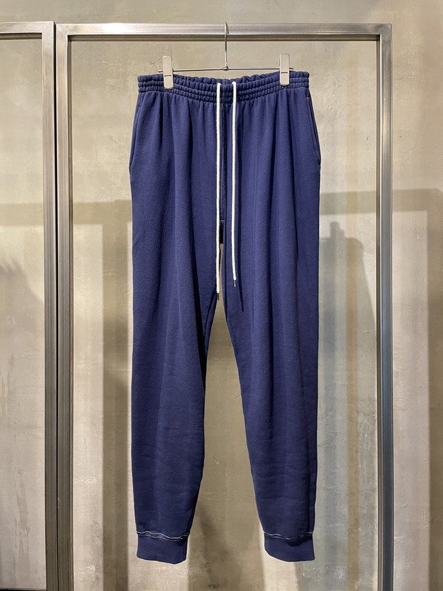 TrAnsference back zip shaped track pants - midnight garment dyed