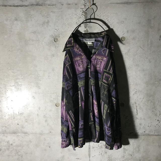 [used] kind of purple designed shirt