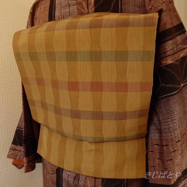 正絹紬 アイボリーに亀甲柄のなごや帯