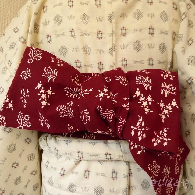 綿 赤に季節の小花模様の半幅帯