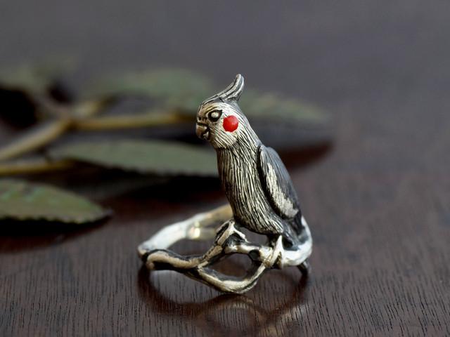 お澄ましオカメインコの指輪