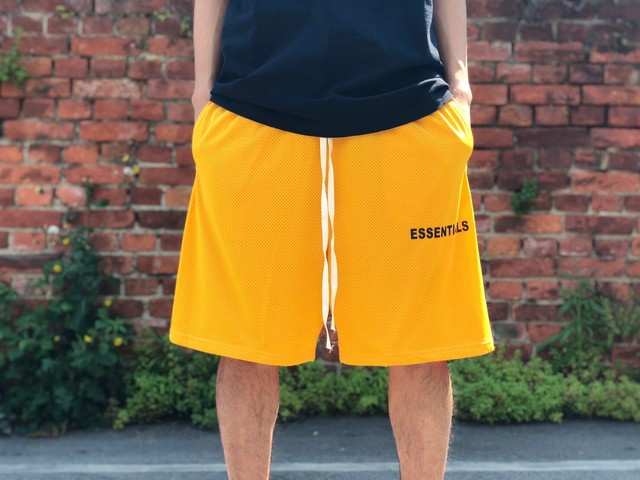 FEAR OF GOD ESSENTIALS LOGO MESH SHORT YELLOW 55IH27907