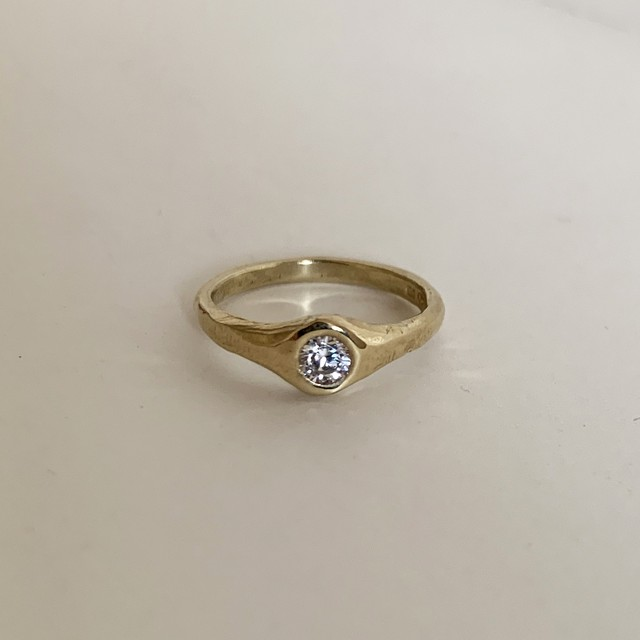 Canna ring with 4mm White CZ Gold