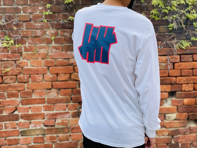 UNDEFEATED CHEST UN LOGO LS TEE WHITE LARGE 10JF6778