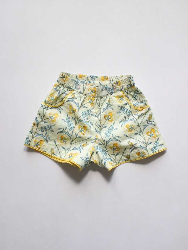 Lali  Begonia shorts mustard wallpaper