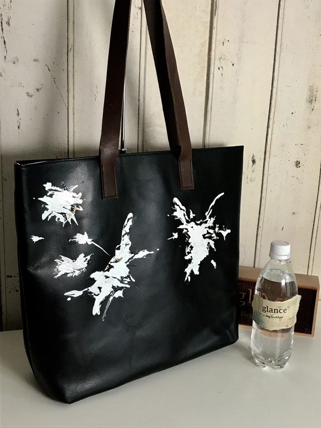 black leather bag / eagle