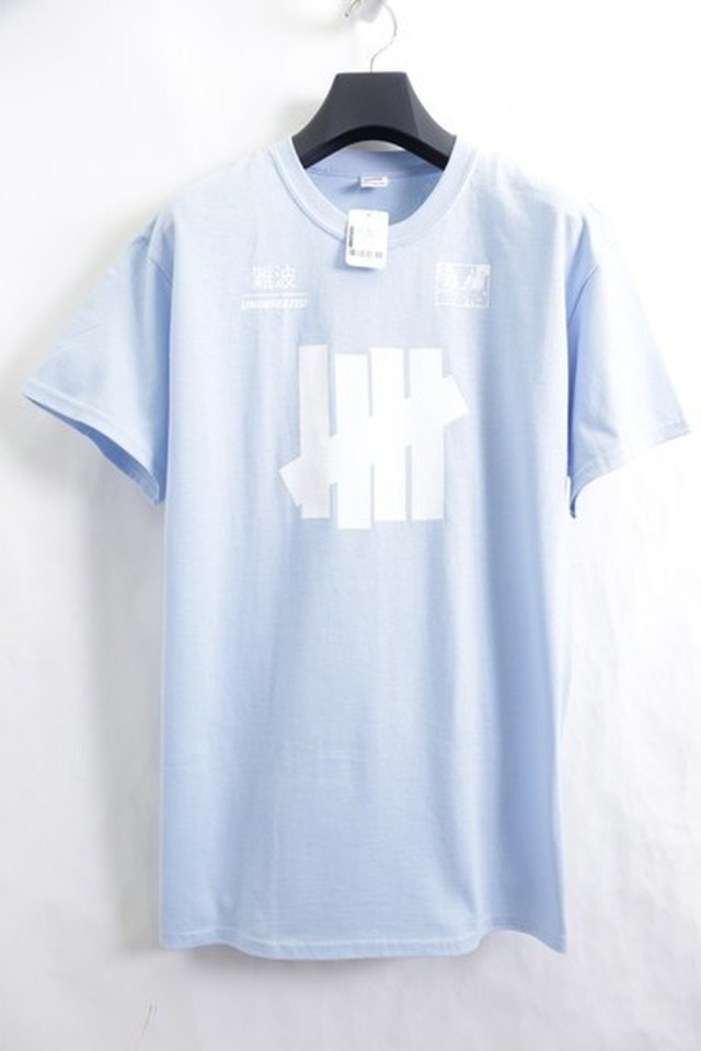 UNDEFEATED NAMBA LIMITED TEE L.BLUE MEDIUM 5JE5965