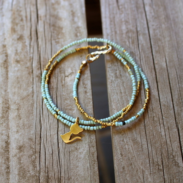 African and Faceted Brass Beads w/Brass Cat and Sterling S hook