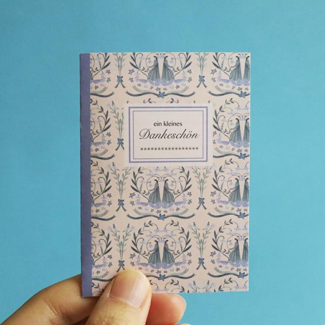 小さなブック型メッセージカード。双子の魔女見習い