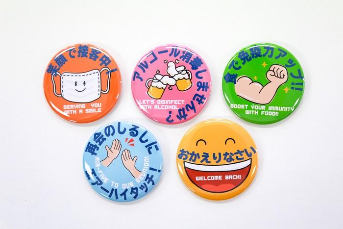 多言語グッズのWEBストアオープン! 第一弾の商品は「コロナ対策メッセージ缶バッジ(日本語、英語)」