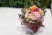 オレンジのバラと季節のお花のブーケタイプの花束